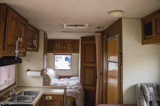 Before: The camper's interiors appeared extremely cramped and dated.