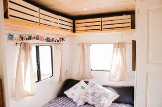 The airy sleeping quarters feature plenty of overhead bin storage.