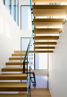 A new interior stair allows vertical circulation and funnels light into the interior space.
