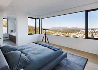 The master bedroom, on the home's top floor, offers panoramic views of the city, bay, and beyond.