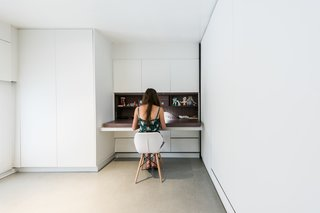 Many of the essential elements required for modern living are tucked into the walls: desks, tables, TVs, ironing boards, and more.