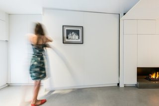 Almost every wall of the apartment is movable, making the compact space exceptionally multifunctional. The mobile elements are set on small wheels, so they can be manually transformed in seconds.