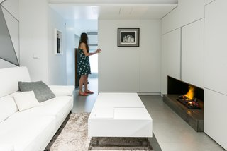 When closed, the wall adjacent to the central living room can create an additional bedroom.