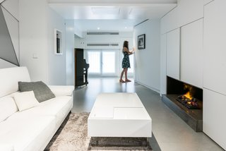 When the bedroom wall is kept open, the couple can enjoy the benefits of a more generously-sized living space.