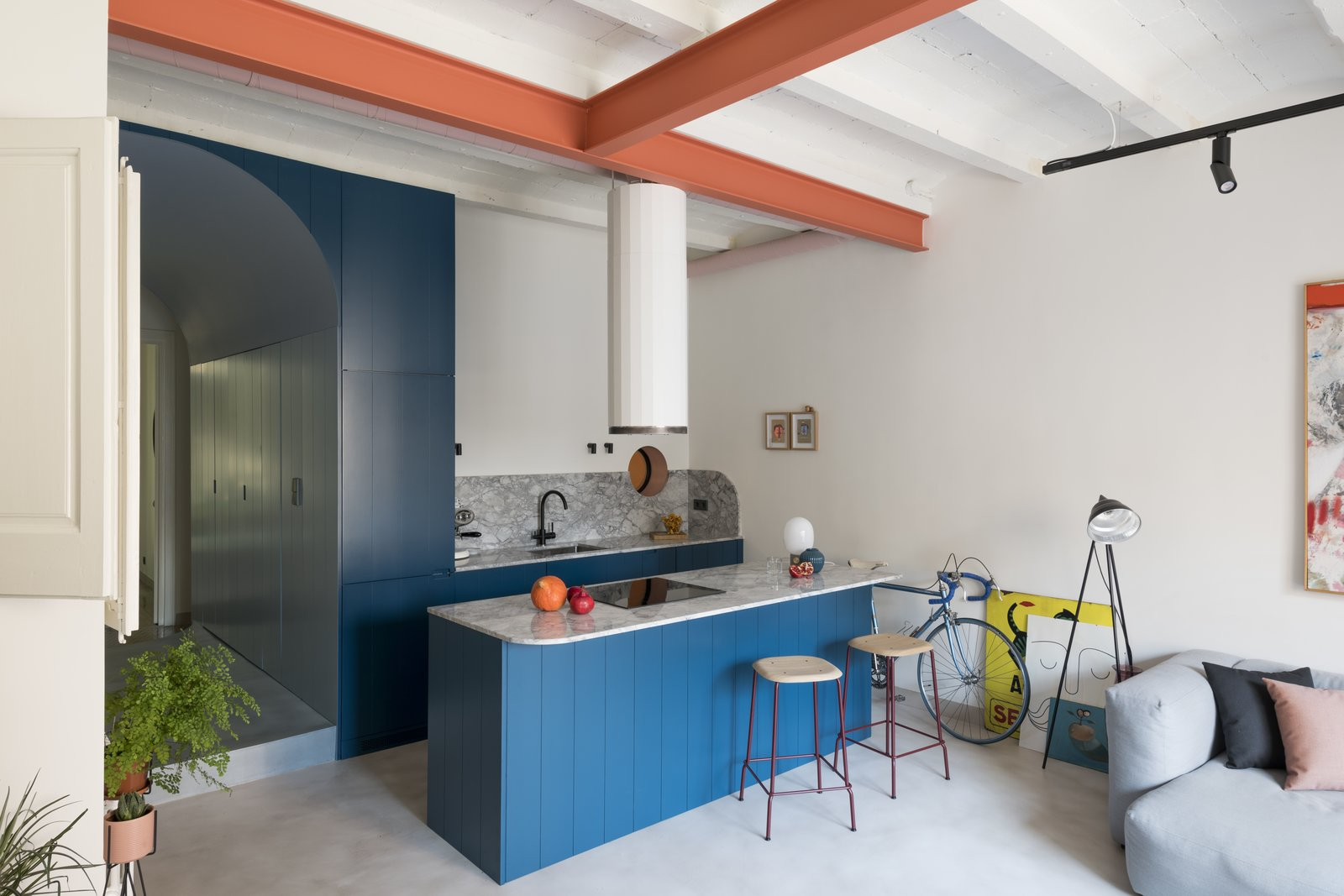 A Compact, Choppy Apartment in Barcelona Gets a Colorful, Quirky Remodel