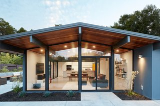 Fresh, bright, and cheery, the updated architecturally significant residence complements the couple's modern lifestyle.