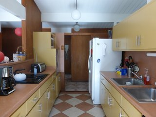 The dated galley kitchen was originally positioned in the middle of the home, sandwiched between the dining room and living room on either side—yet lacking connection to either.