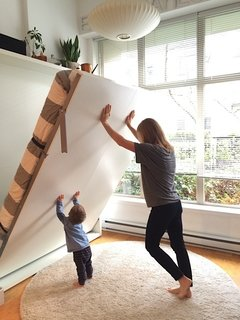 Theo helps his mom put the Penelope up in the morning!