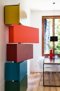 The playful Giralot features storage modules that rotate open.