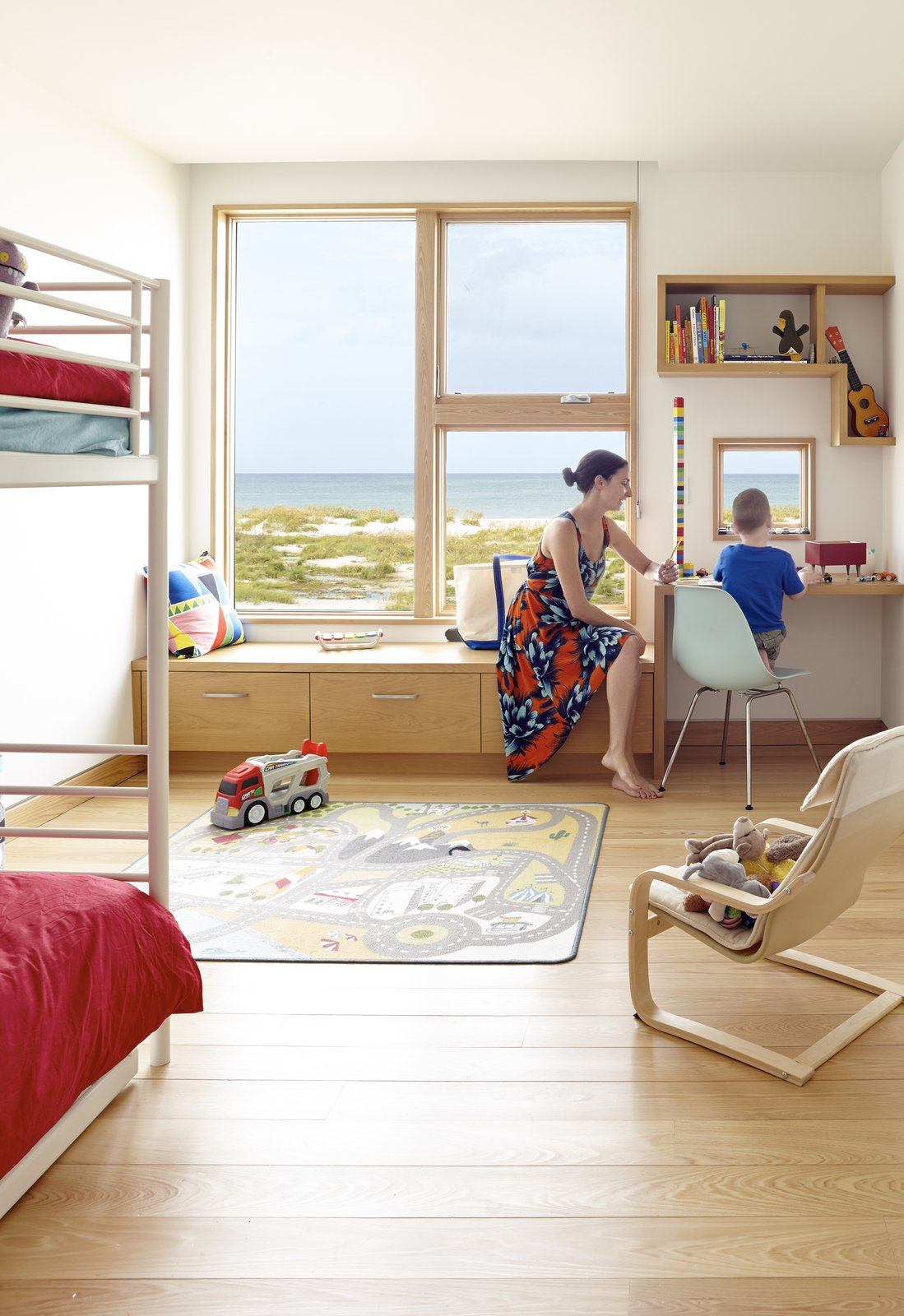 Kids Room, Bedroom Room Type, Bed, Storage, and Light Hardwood Floor  Seagrape House by Traction Architecture