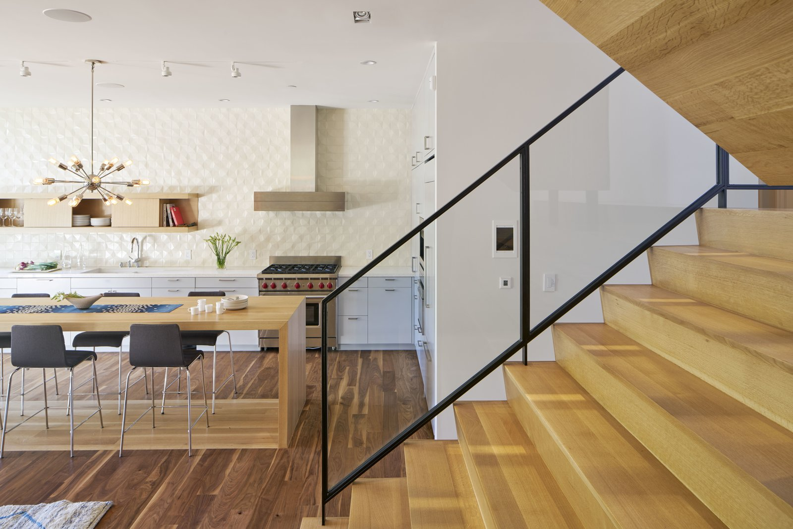 Dining Room, Track Lighting, Dark Hardwood Floor, Bar, Pendant Lighting, and Chair  29th Street Residence by Schwartz and Architecture