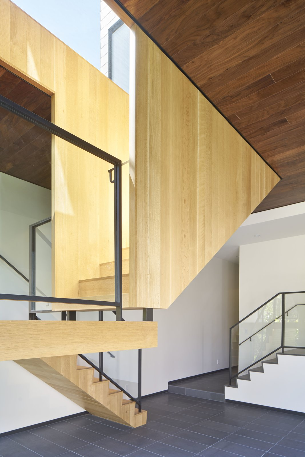 Staircase, Wood Tread, Metal Railing, and Glass Railing  29th Street Residence by Schwartz and Architecture