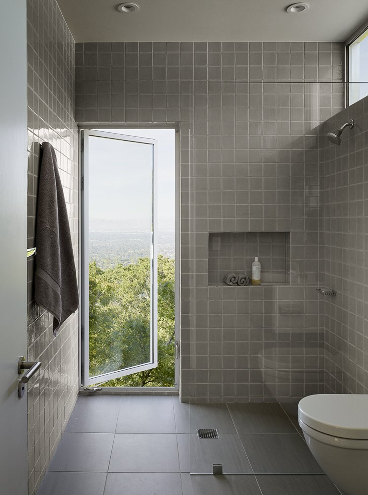 Tagged: Bath Room, Ceiling Lighting, Porcelain Tile Floor, Ceramic Tile Wall, One Piece Toilet, and Recessed Lighting.  Photo 11 of 15 in What's the Best Way to Save Space in a Small Bathroom? from Shou Sugi Ban House
