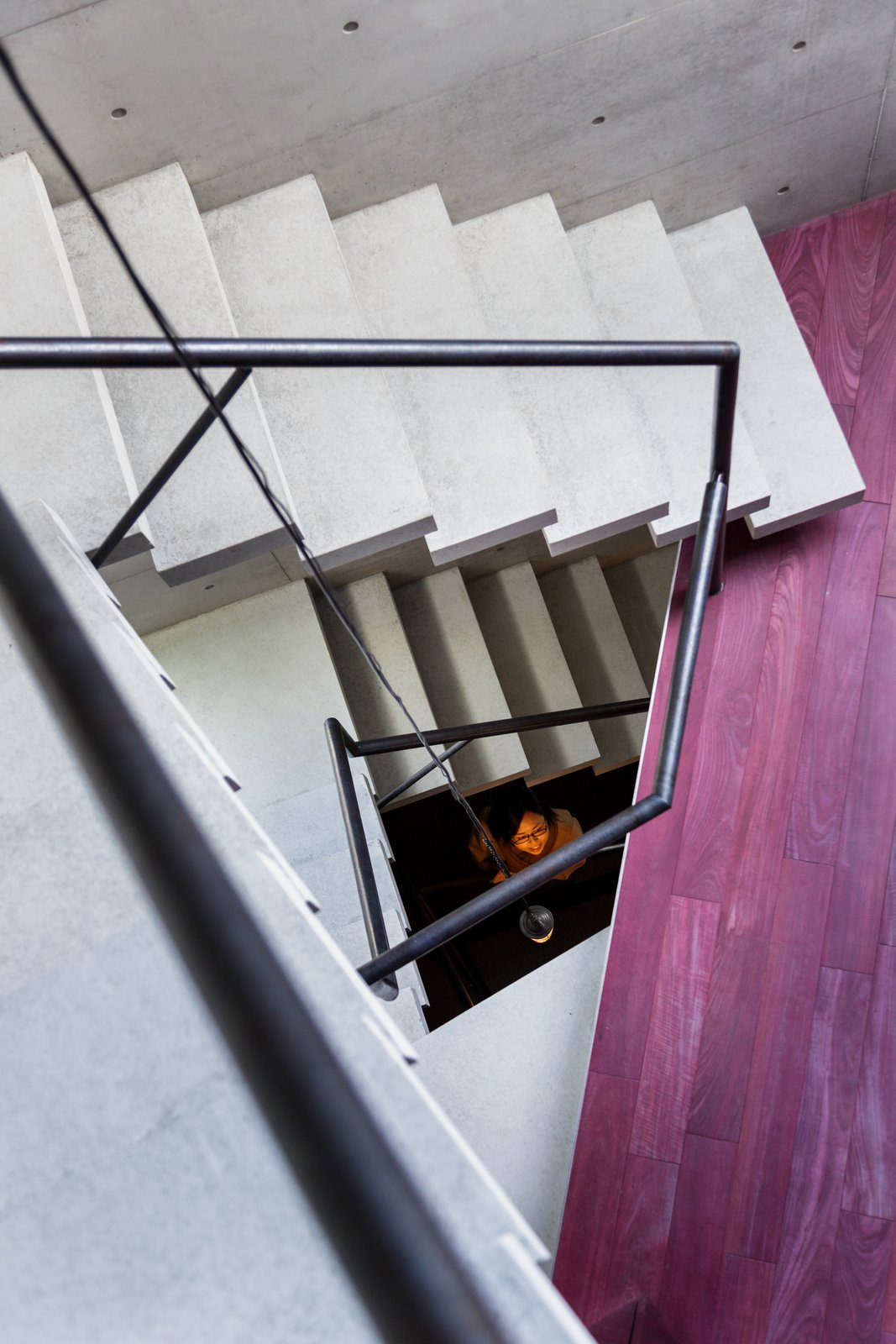 Staircase, Metal Railing, and Concrete Tread  Photo 4 of 16 in A Concrete Micro-House in Japan Works All the Angles