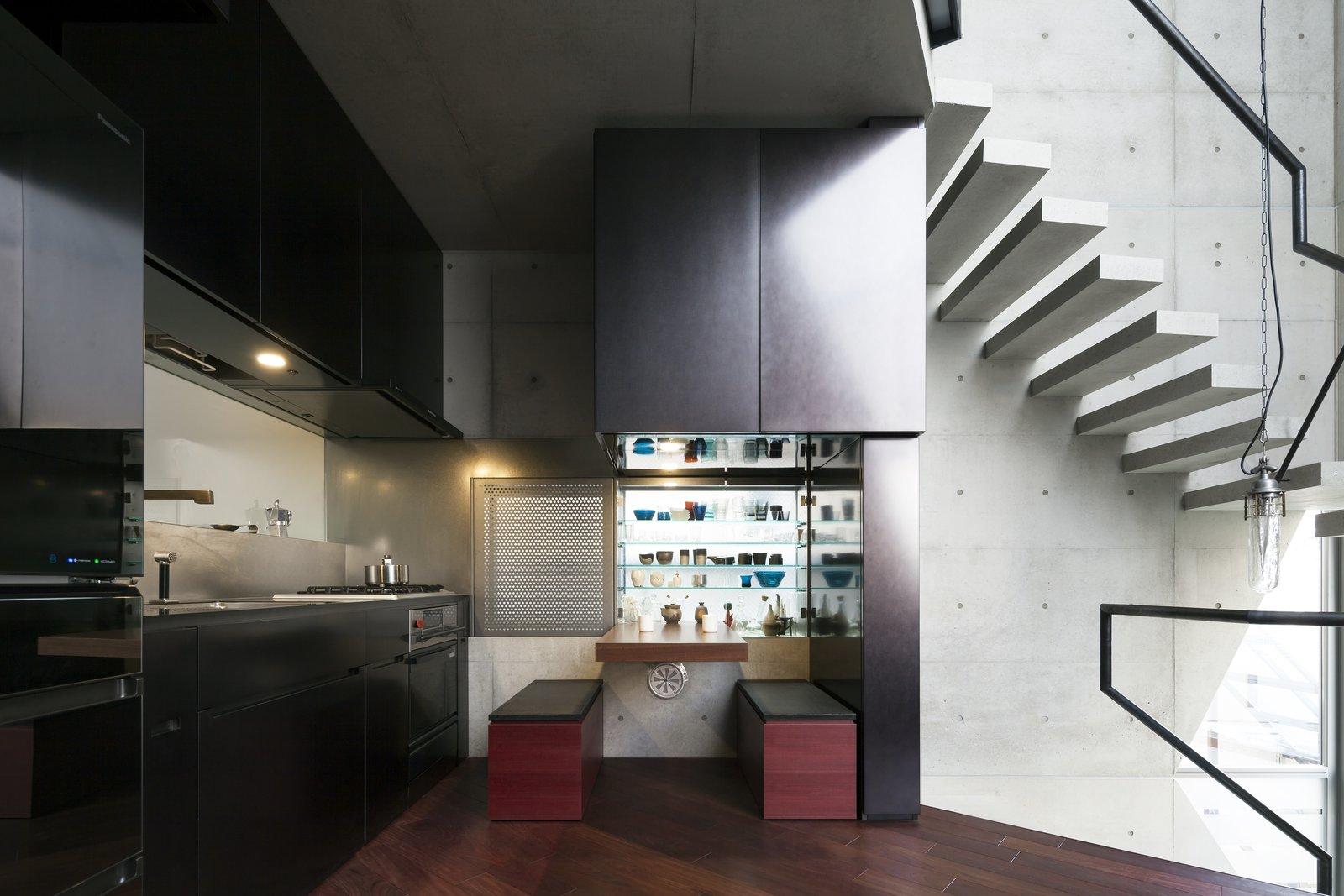 Kitchen, Range, Dark Hardwood Floor, Pendant Lighting, Range Hood, Metal Cabinet, and Undermount Sink  Photo 7 of 16 in A Concrete Micro-House in Japan Works All the Angles