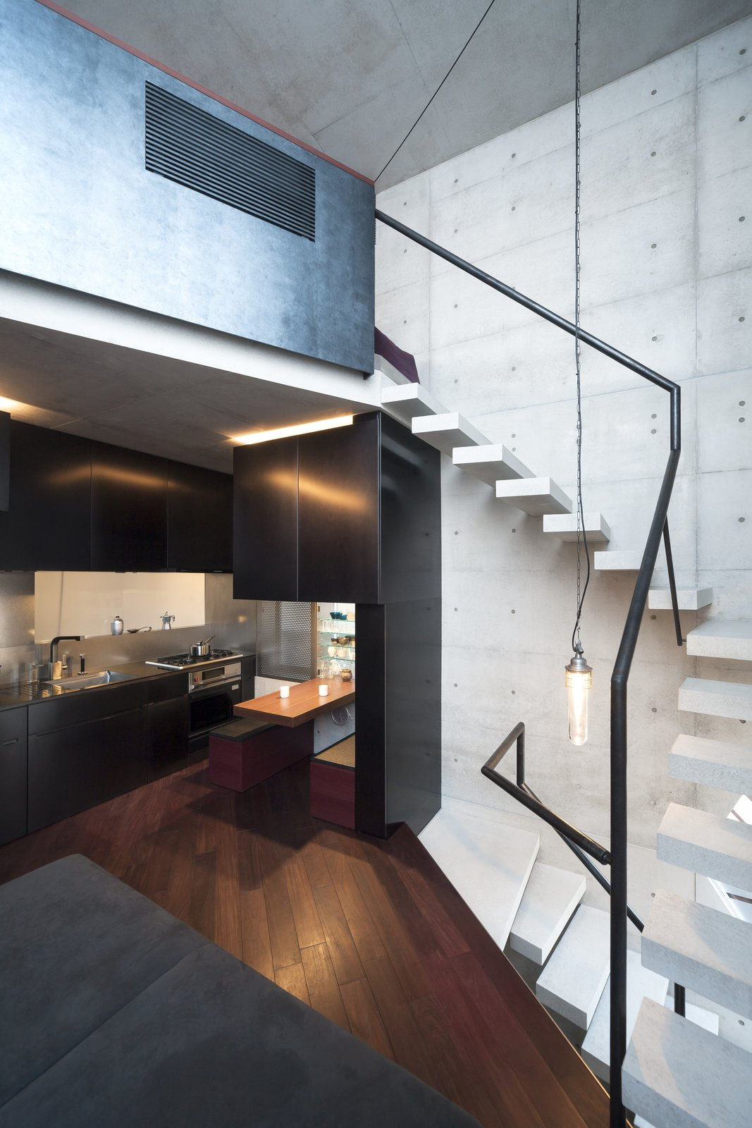 Staircase, Metal Railing, and Concrete Tread  Photo 6 of 16 in A Concrete Micro-House in Japan Works All the Angles
