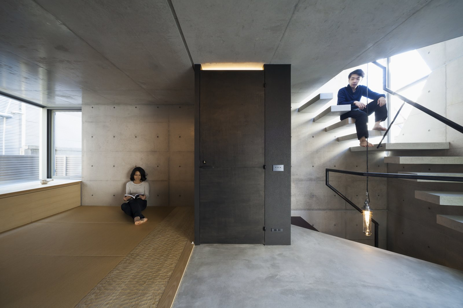 Office, Study Room Type, Concrete Floor, and Storage  Photo 14 of 16 in A Concrete Micro-House in Japan Works All the Angles