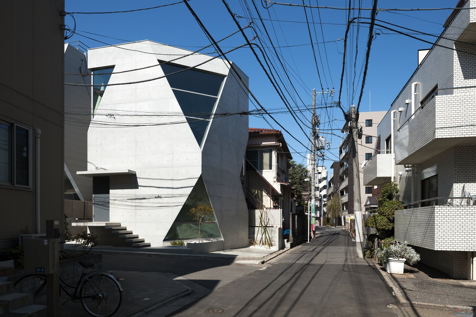 Exterior, House Building Type, and Concrete Siding Material  Photo 3 of 16 in A Concrete Micro-House in Japan Works All the Angles