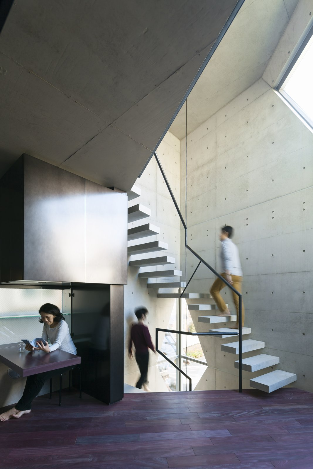 Staircase, Concrete Tread, and Metal Railing  Photo 9 of 16 in A Concrete Micro-House in Japan Works All the Angles