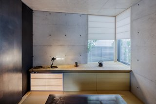 A Concrete Micro-House in Japan Works All the Angles - Dwell on micro house windows, micro house deck, micro house interior, micro house building, micro house exterior, micro house glass, micro house bed, micro house storage, micro house living, micro house library, micro house bedroom, micro house loft, micro house with garage, micro house furniture, micro house kitchen, micro house snow, micro house cabinets, micro house cabin, micro house studio, micro house design,