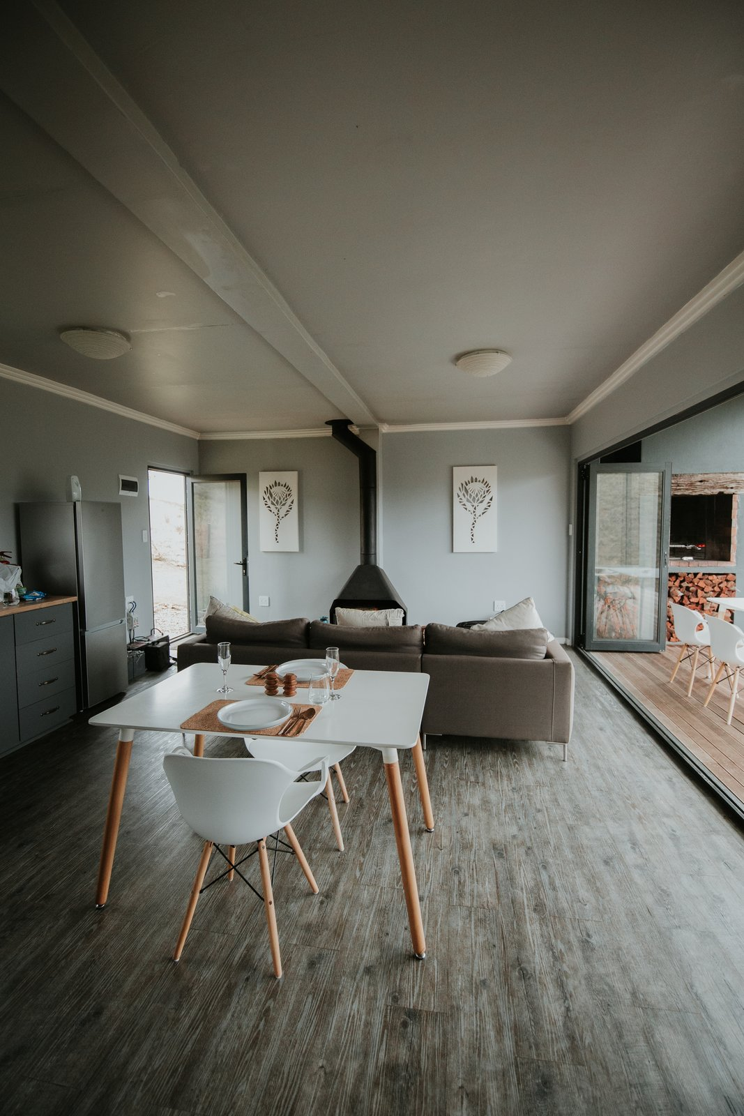 Dining, Chair, Table, Wood Burning, Ceiling, and Dark Hardwood  Best Dining Wood Burning Dark Hardwood Photos from Take in the South African Countryside in This Shipping Container Eco-Cabin