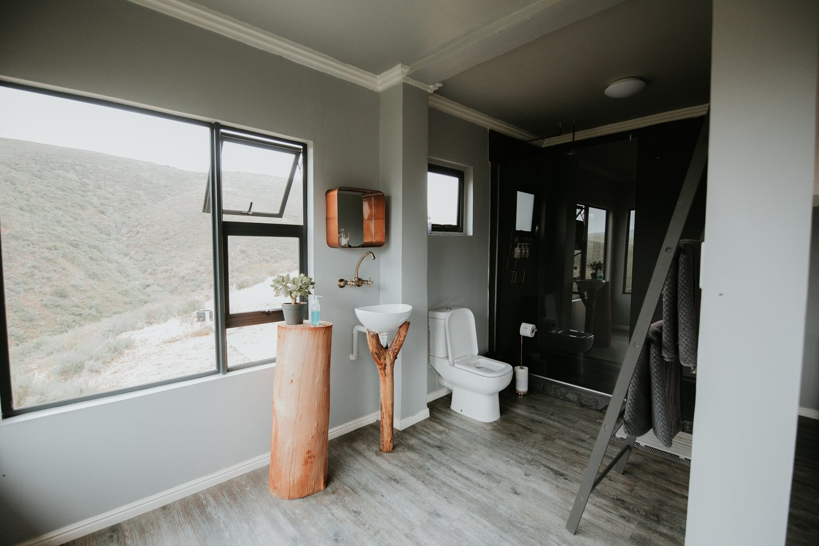 Bath, One Piece, Vessel, Dark Hardwood, Enclosed, Wood, and Ceiling  Best Bath One Piece Vessel Enclosed Photos from Take in the South African Countryside in This Shipping Container Eco-Cabin