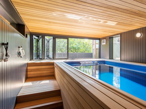 """""""The property does not have a conventional backyard, so the pool is a place where the adults can get some exercise, and the two young children can play. From here, the evening sun streams through the slide-fold doors, creating a lovely ambiance,"""" Schaer explains."""