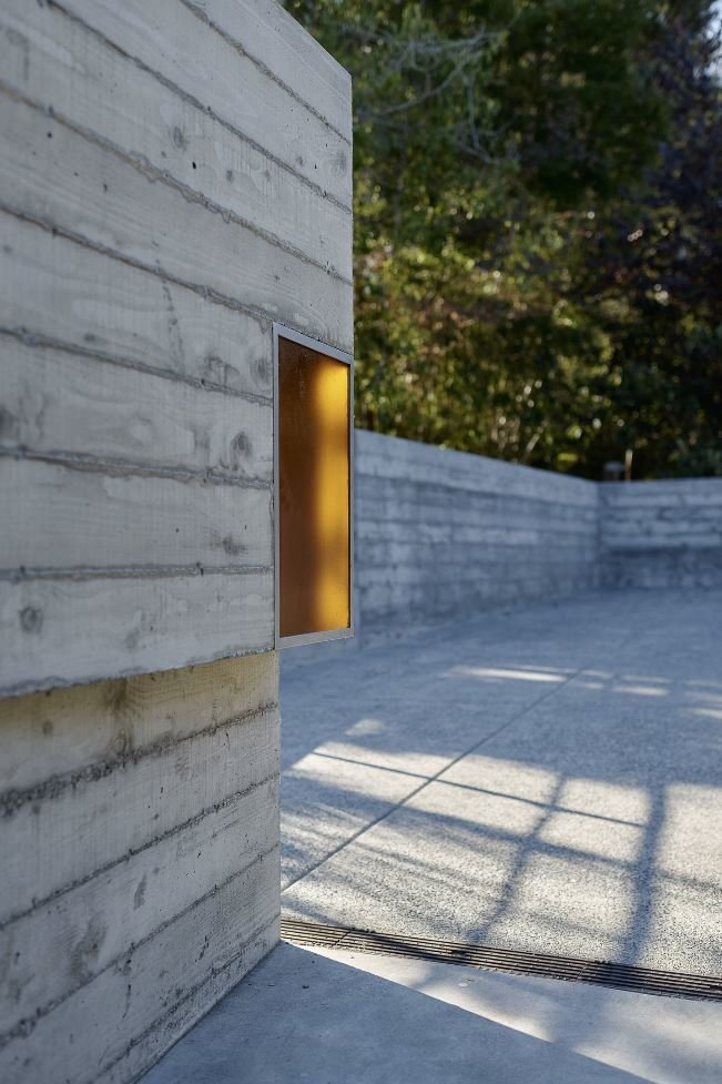 Outdoor, Side Yard, Concrete Patio, Porch, Deck, and Concrete Fences, Wall  Photos from Haiku House