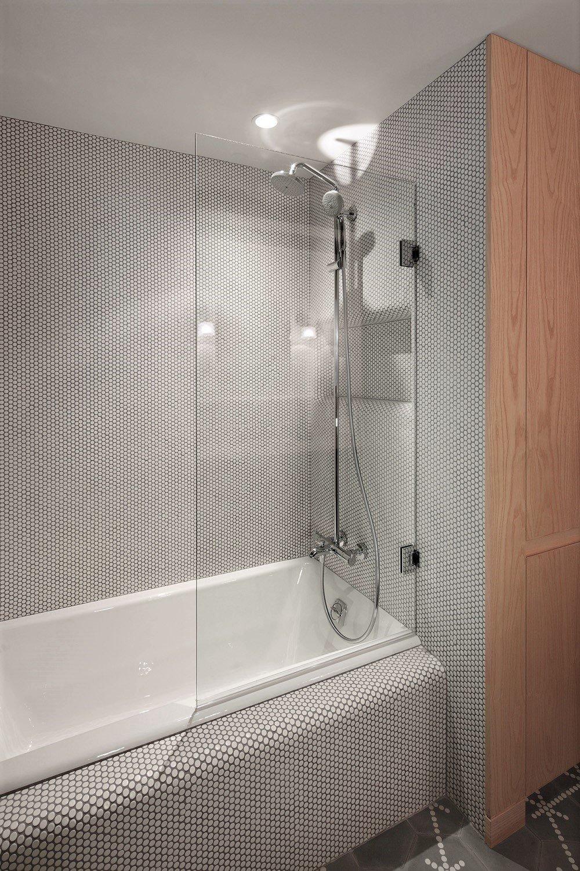 Bath Room, Porcelain Tile Floor, Ceramic Tile Floor, Alcove Tub, Corner Shower, Ceramic Tile Wall, Enclosed Shower, and Ceiling Lighting  Haiku House by SHED Architecture & Design