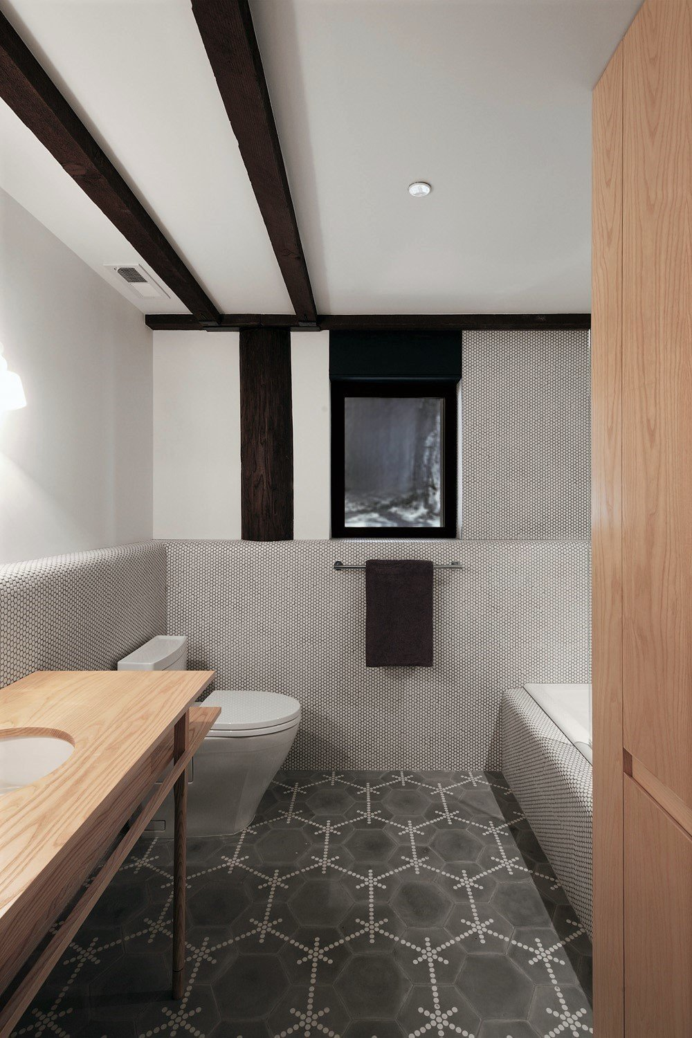 Bath Room, Wood Counter, Ceramic Tile Floor, Ceramic Tile Wall, Alcove Tub, One Piece Toilet, Drop In Sink, and Ceiling Lighting  Haiku House by SHED Architecture & Design