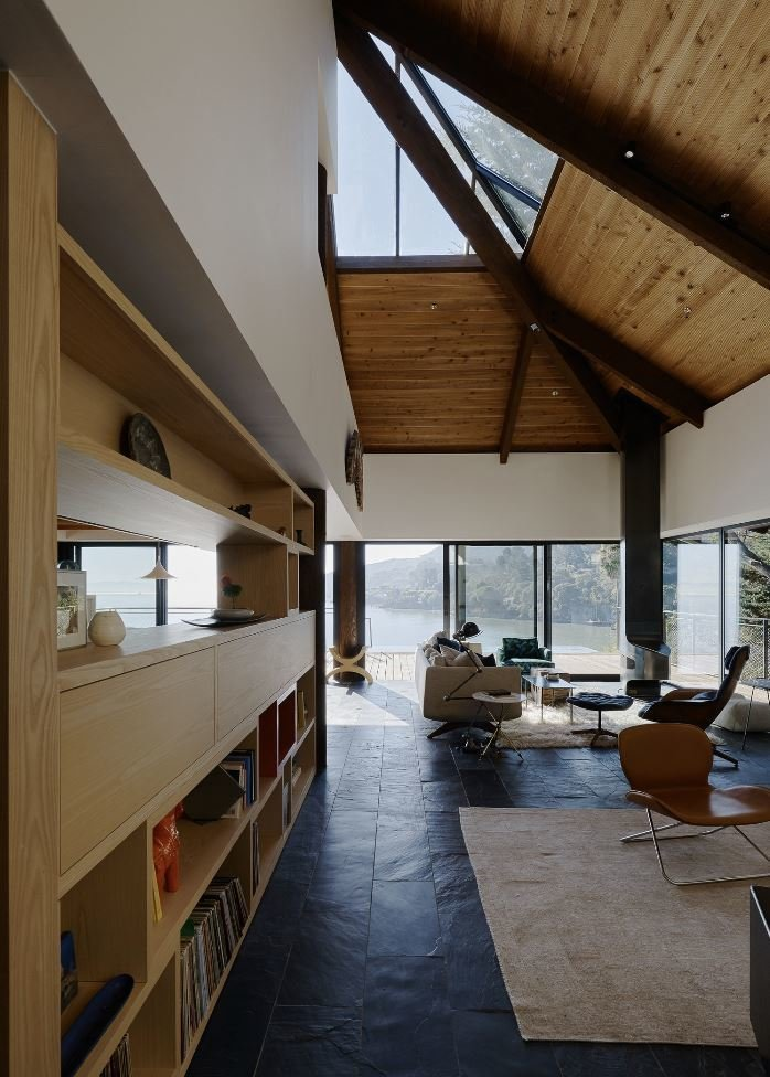 Living Room, Ottomans, Chair, Rug Floor, Wood Burning Fireplace, and Sofa  Haiku House by SHED Architecture & Design