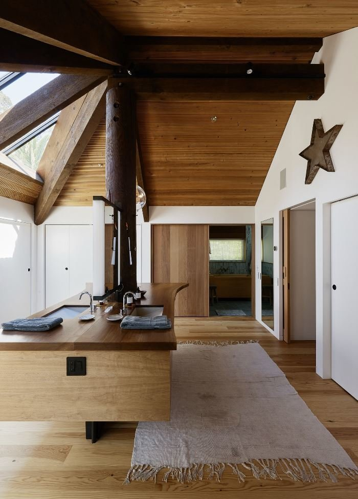 Bath Room, Wood Counter, Ceiling Lighting, Light Hardwood Floor, and Drop In Sink  Haiku House by SHED Architecture & Design