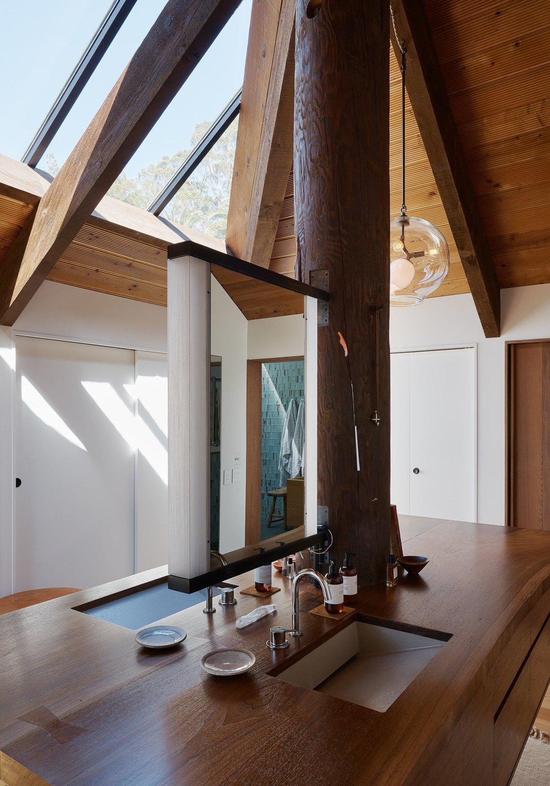 Bath Room, Light Hardwood Floor, Wood Counter, Drop In Sink, and Medium Hardwood Floor  Haiku House by SHED Architecture & Design