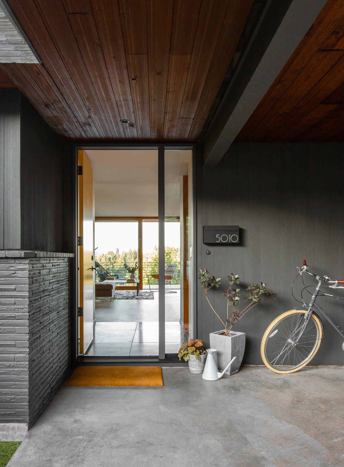Exterior, House Building Type, Mid-Century Building Type, Wood Siding Material, Brick Siding Material, and Flat RoofLine  Photos from Irwin Caplan Midcentury