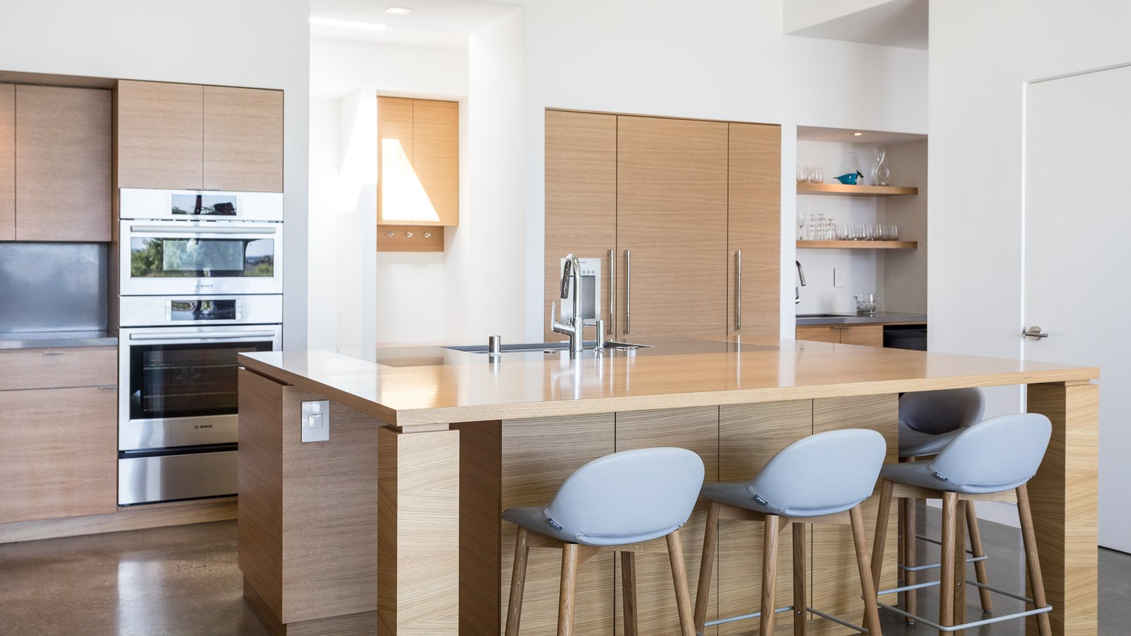 Kitchen, Concrete Floor, Wood Cabinet, Recessed Lighting, Engineered Quartz Counter, Undermount Sink, and Refrigerator  Best Photos from Folsom