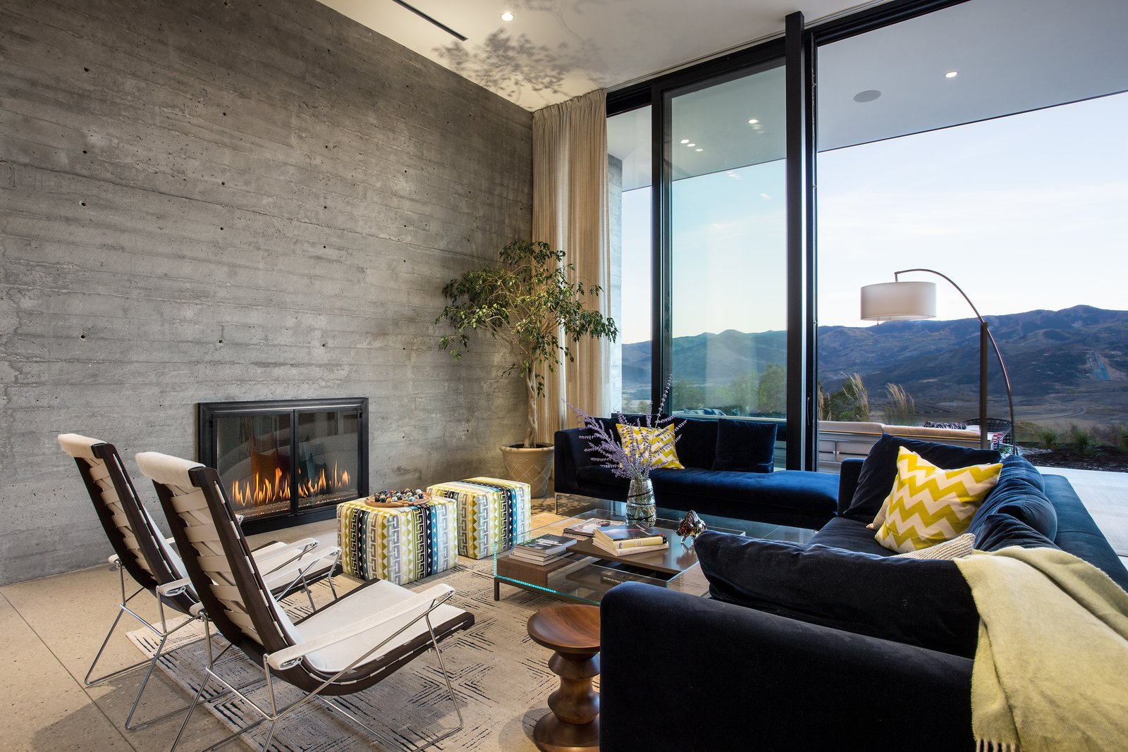 Living Room, Chair, Recessed Lighting, Floor Lighting, Ottomans, Sofa, Coffee Tables, End Tables, Rug Floor, Lamps, and Standard Layout Fireplace  Park City Modern Residence by Sparano + Mooney Architecture