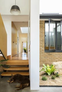 A look at the  interface between old and new through the original yellow-brick dwelling.