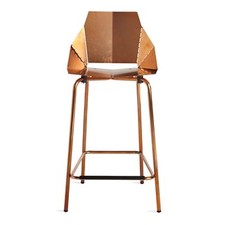 A copper-plated finish coats this counter stool by Blu Dot, which ships flat and folds along laser-cut lines to create a dynamic chair.