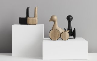 Swan and Ducky figures in natural and black oak.