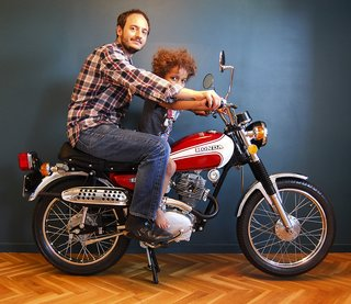 Marc Venot together with his son on his Honda from 1974.