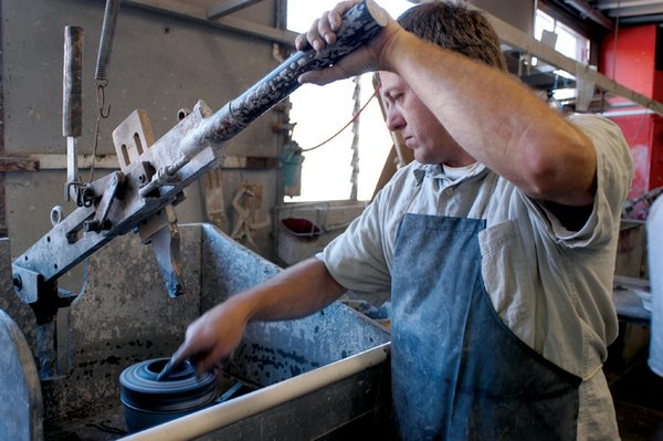 This process is called manual jiggering. An inner profile of a form is pulled down and spreads the clay into a rotating plaster form. Water is sponged on to each piece to smooth the surface. Our automated jigger machines make bowls by spreading clay into a spinning plaster mold.