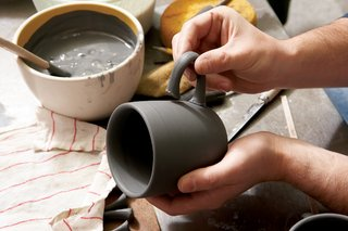 Each handle is slipcast and the cups are jiggered separately. The cup handle is then applied by hand.
