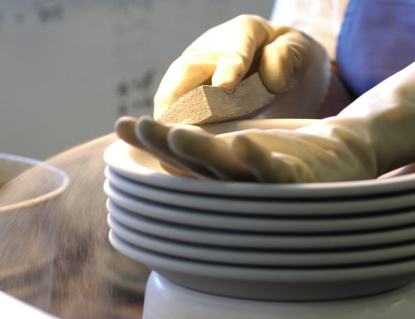 Each piece is wiped with a wet sponge to smooth the surface.