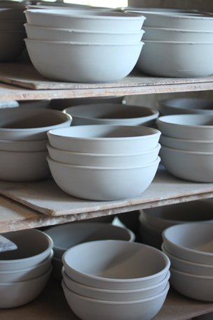 Once dry, the ware is ready for glazing. We keep some stock of all our pieces in greenware (unfired) so that we have them ready to glaze when we need them.