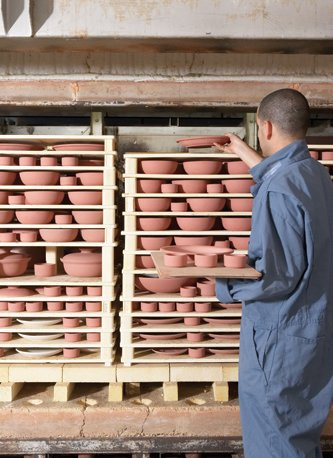 The pieces are stacked like a puzzle, using kiln furniture, into our top-hat kilns.  Photo 28 of 36 in Sausalito Dinnerware Factory Tour