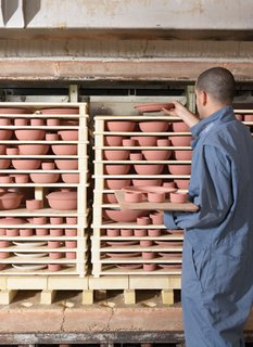 The pieces are stacked like a puzzle, using kiln furniture, into our top-hat kilns.