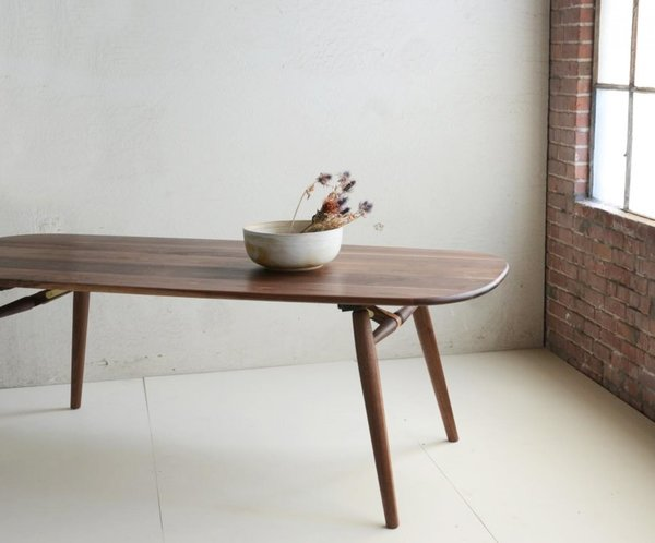 Made with constantly moving city dwellers in mind, Dave developed the Nomad table (shown here in Natural Walnut) which conveniently packs down for easy travel.