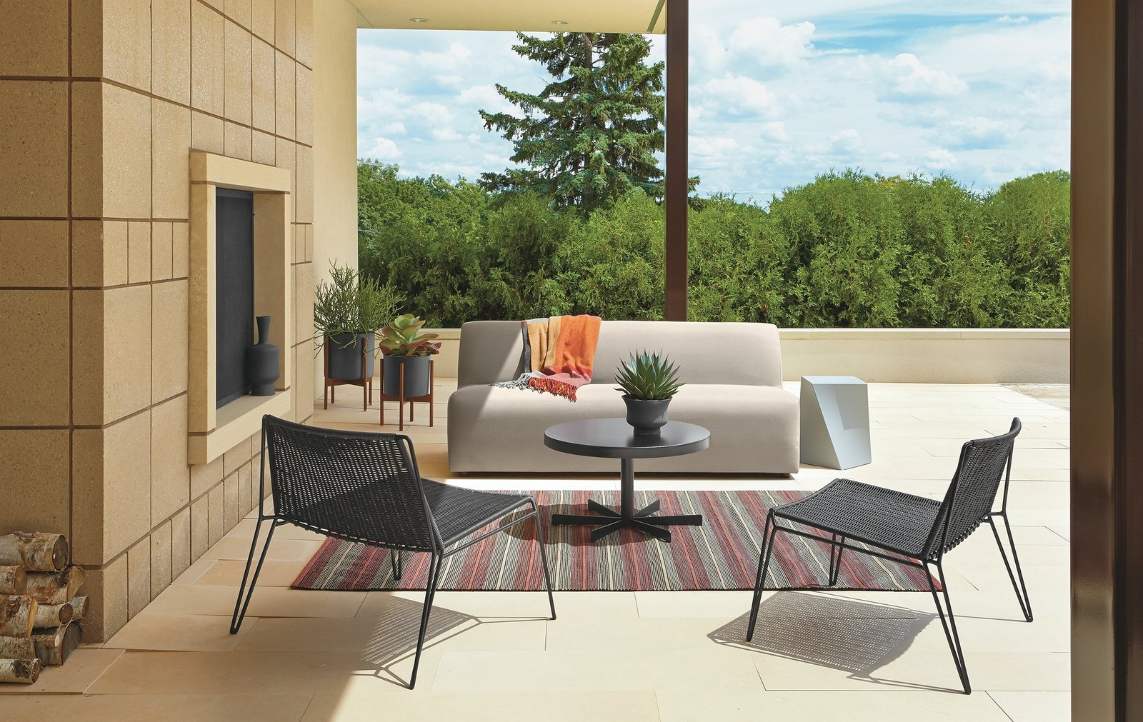 Outdoor, Large Patio, Porch, Deck, Planters Patio, Porch, Deck, Concrete Patio, Porch, Deck, Trees, and Raised Planters Laguna sofa, Penelope lounge chairs, Penelope cocktail table, Case Study planters  Photo 4 of 8 in Expert Design Advice: Outdoor Dining Spaces