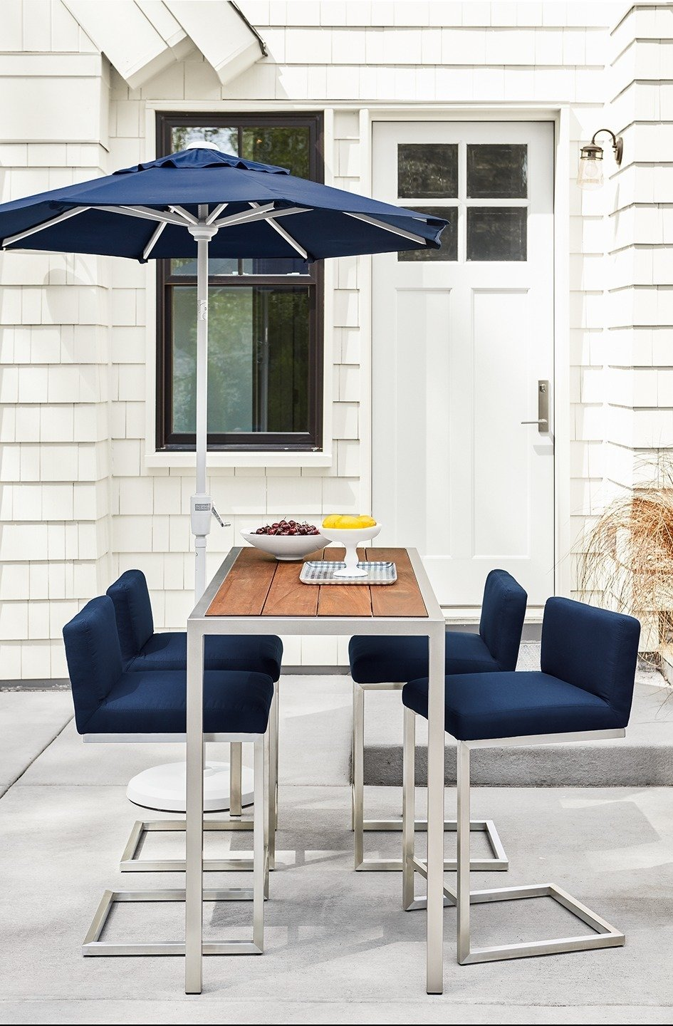 Outdoor, Concrete Patio, Porch, Deck, and Back Yard Montego counter table, Finn counter stools, Maui umbrella  Photo 6 of 8 in Expert Design Advice: Outdoor Dining Spaces