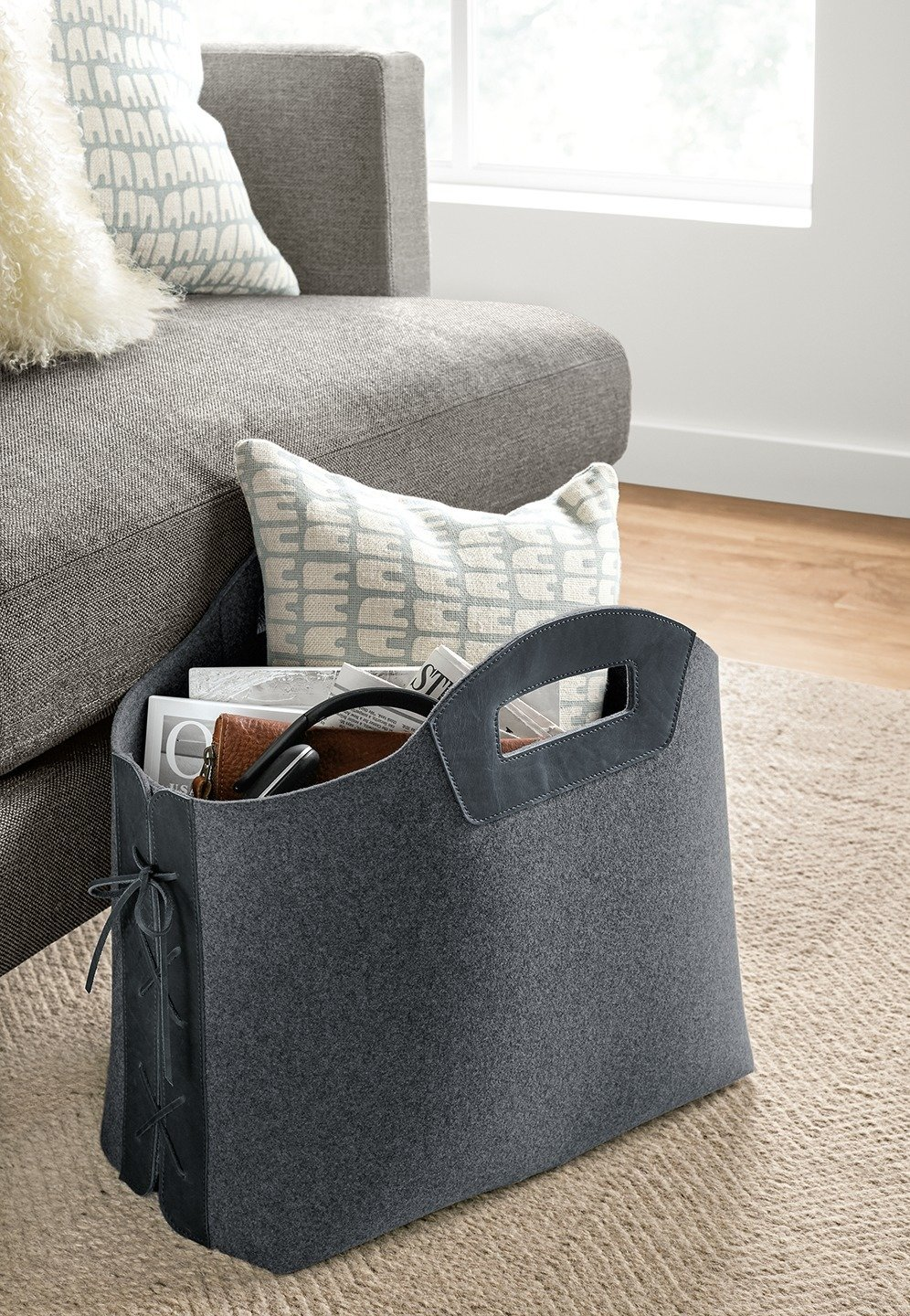 Storage Room Store magazines and more in this sturdy felt tote. Leather laces and handles create a sophisticated mix of materials. The tote stands upright so you can easily place it next to your sofa or under your desk.  Photo 2 of 9 in How to Use Modern Home Decor in Unexpected Ways from Modern Home Decor